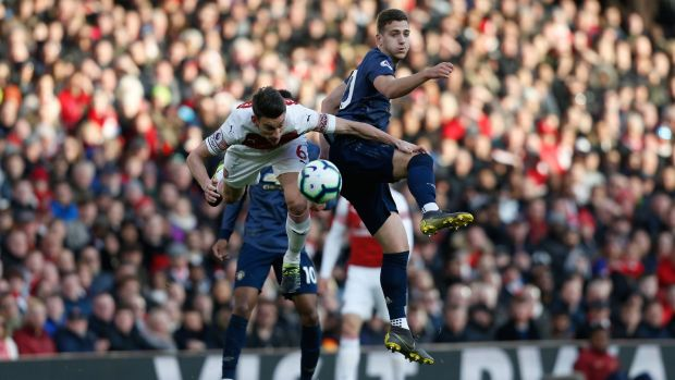 Koscielny and Dalot compete for the ball. Photo: Ian Kington/Getty Images
