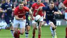 Wales wing George North and Scotland's Byron McGuigan chase the ball during the Six Nations match at Murrayfield Stadium in Edinburgh. Photograph: Andy Buchanan/AFP/Getty Images