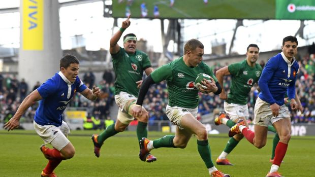 Keith Earls (C) runs in Ireland's fourth try after France's Demba Bamba lost sight of his role. Photograph: Damien Mayer/AFP/Getty Images