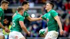 Jonathan Sexton celebrates scoring Ireland's second try of the game with Jordan Larmour, Garry Ringrose and Conor Murray. Photograph: Ryan Byrne/Inpho