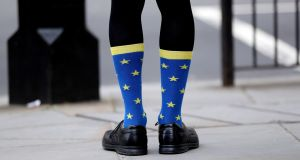 A Remain supporter sports European-flag socks: Ireland has saved Britain from the disaster of a hard Brexit and perhaps even from Brexit itself. Photograph: Jonathan Brady/PA