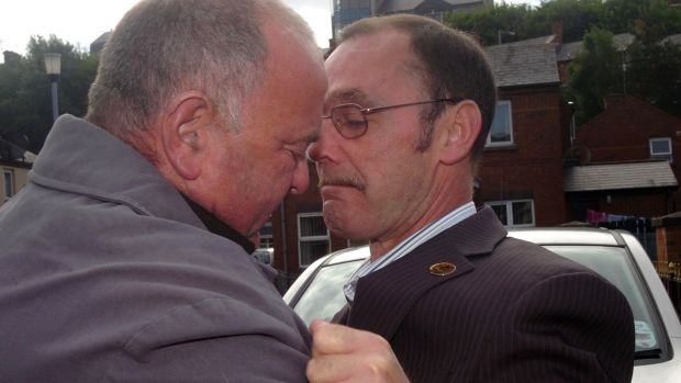 Joe Mahon (left) embraces Liam Wray, brother of Jim Wray, ahead of the publication of the Saville Report. Injured on Bloody Sunday, Joe lay beside Jim and saw a soldier shoot him in the back a second, fatal, time. Photograph: Courtesy of Derry Journal