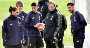 Juventus coach Massimiliano Allegri and players during training in Turin, Italy, before their home game against Atletico Madrid. Photograph: Reuters/Massimo Pinca