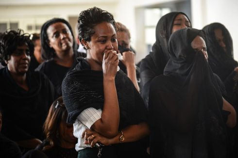 LOST COLLEAGUES: Women mourn during a memorial ceremony for the seven crew members who died in the Ethiopian Airlines plane crash at the Ethiopian Pilot Association Club in Addis Ababa, Ethiopia, on Monday. Photograph: AFP/Getty