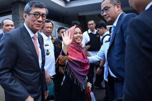 TASTE OF FREEDOM: Siti Aisyah, an Indonesian national, waves after a press conference, next to Indonesia's minister of law and human rights Yasonna Laoly (left) in Jakarta. Ms Aisyah has been released from custody in Malaysia after having been accused of involvement in the killing of North Korean leader Kim Jong-un's brother Kim Jong-nam in Kuala Lumpur two years ago. Photograph: Adek Berry/AFP/Getty