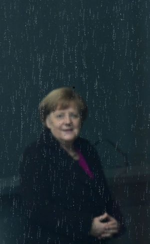 WET IN BERLIN: Germany's Chancellor Angela Merkel awaits the arrival of Latvia's prime minister Krisjanis Karins in Berlin for talks. Photograph: Tobias Schwarz/AFP/Getty Images