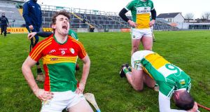 Carlow's Sean Whelan celebrates  while Pat Camon  of Offaly shows his  dejection following Carlow's win in the Division 1B relegation playoff at O'Connor Park. Photograph: Tom O'Hanlon/Inpho