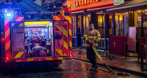 A fireman is seen  in the Temple Bar area where a fire led to the evacuation of an apartment complex.  Photograph: James Forde/The Irish Times.