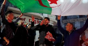 People celebrate on the streets after President Abdelaziz Bouteflika announced he will not run for a fifth term, in Algiers on Monday. Photograph: Zohra Bensemra/Reuters