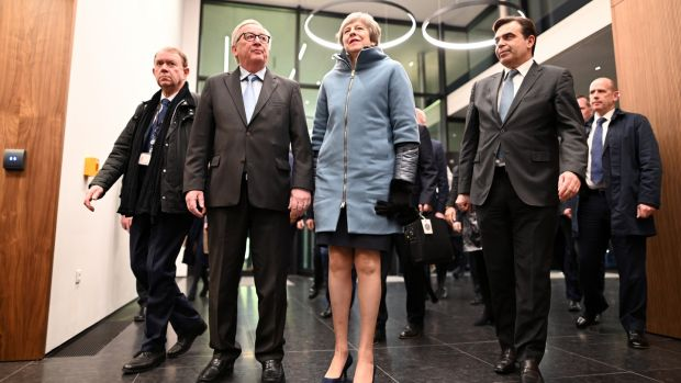 Jean-Claude Juncker, president of the European Commission, welcomes British prime minister Theresa May at the European Parliament in Strasbourg on Monday night. Photograph: Patrick Seeger/EPA.