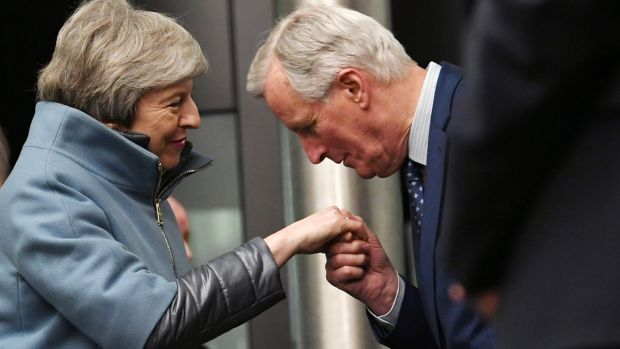 Chief European Union Brexit negotiator Michel Barnier kisses the hand British prime minister Theresa May as she arives at the European Parliament in Strasbourg on Monday night. Photograph: Patrick Seeger/EPA.