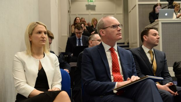 Helen McEntee and Simon Coveney listen to Leo Varaadkar at a press conference in Government Buildings on Tuesday morning. Photograph: Dara Mac Dónaill