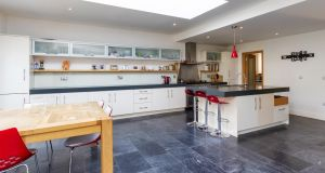 The kitchen has Corian countertops and the island includes a clever open drawer set under its counter where you can throw keys, hats, scarves and other stuff that clutters up the worktop
