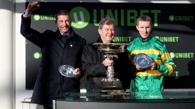 Trainer Gavin Cromwell, owner JP McManus and jockey Mark Walsh after Espoir D'Allen's victory in the Unibet Champion Hurdle at Cheltenham. Photograph: Simon Cooper/PA Wire