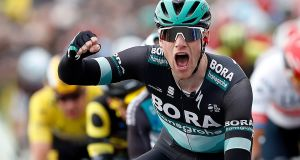 Ireland's Sam Bennett of Bora Hansgrohe team celebrates while crossing the finish line to win the third stage of the Paris-Nice. Photograph: EPA