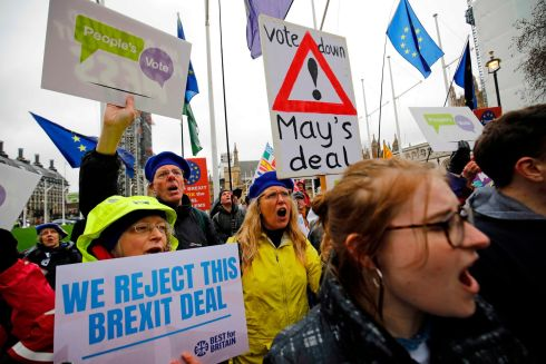 PEOPLE POWER: Anti-Brexit activists calling for a People's Vote on the issue demonstrate outside the Houses of Parliament in London ahead of the second meaningful vote on the government's Brexit deal. Photograph: Tolga Akmen/AFP/Getty