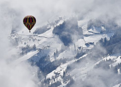 BLOWING HOT AND COLD: A hot air balloon soars during the International Ballooning Days Achensee event in Achenkirch, Austria. Photograph: Angelika Warmuth/EPA