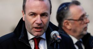 Manfred Weber, above, said Orbán must end the poster campaign and his harsh anti-EU rhetoric. Photograph: Laszlo Balogh/Getty Images