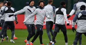 Mohamed Salah of Liverpool joins teammates during a training session. Photograph: Paul Ellis/AFP/Getty Images