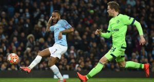 Raheem Sterling scores Manchester City's fourth goal during the Champions League round of 16 second leg against Schalke at the Etihad stadium. Photograph: Oli Scarff/AFP/Getty Images