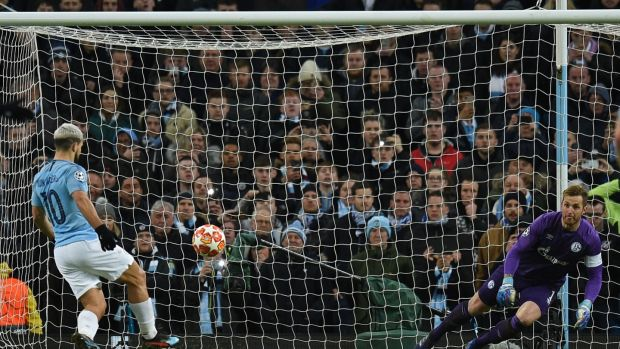 Manchester City's Sergio Agüero chips Schalke Ralf Fährmann with a penalty kick during the Champions League round of 16 second leg match at the Etihad stadium. Photograph: Oli Scarff/AFP/Getty Images