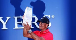 Tiger Woods lifts The Players trophy in 2013. Photograph: Andy Lyons/Getty