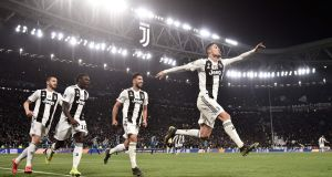 Juventus' Cristiano Ronaldo celebrates after scoring his third goal in the Champions League last-16 second leg win over Atletico Madrid. Photo: Marco Bertorello/Getty Images