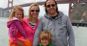 Sylvia McLaughlin works in the Irish Consulate in San Francisco. Here she is at the Golden Gate Bridge with her husband, Gary Foley, and their children, Aoibhe and Aaron
