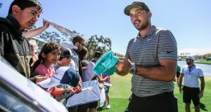 Jason Day signs autographs as he walks off the 18th green during practice for The Players Championship at TPC Sawgrass in Ponte Vedra Beach, Florida. Photo: Tannen Maury/EPA