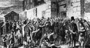 1846: starving peasants clamour at the gates of a workhouse during the Famine. Photograph: Hulton Archive/Getty Images