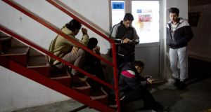 Migrants wait for medical assistance at a migrant facility in Bihac in Bosnia-Herzegovina. Photograph:  Darko Bandic/AP