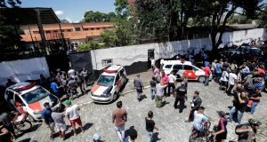 Crowds including police outside  a school after fatal shootings,  in the metropolitan region of Sao Paulo, Brazil, on Wednesday. Photograph: Sebastiao Moreira/EPA
