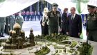 Russia's president Vladimir Putin looks at a model of the Russian armed forces' main cathedral in the military theme park, Patriot Park, on September 18th, 2018. Photograph: Alexei Nikolsky/Getty