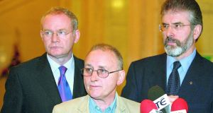 Martin McGuinness, Denis Donaldson and Gerry Adams in Stormont in December 2005. Photograph: Paul Faith/PA