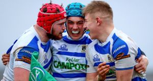Garbally's Oisin McCormack celebrates scoring a try with Jack Dempsey and Cormac Finn during the Connacht Schools Senior Cup final. Photo: Tommy Dickson/Inpho