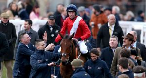 Jamie Codd celebrates Champion Bumper victory on Envoi Allen. Photograph: Paul Harding/PA