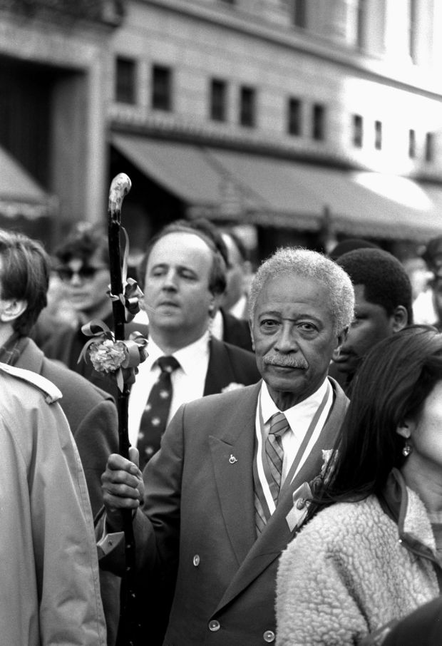New York Mayor David Dinkins marches in St Patrick's Day Parade, subjected to catcalls from spectators angered by his support of LGBT marchers. Photograph: Gerald Herbert/NY Daily News Archive via Getty Images