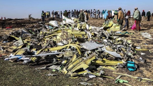 People stand at the crash site of Ethiopia Airlines flight 302, near Bishoftu south of Addis Ababa, in which 157 people died. Photograph: MichaelTewelde/AFP/Getty Images