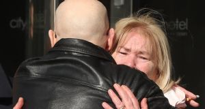 Linda Nash whose youngest brother William Nash died on Bloody Sunday with Eamonn McCann outside the city hotel. Photograph: Niall Carson/PA Wire