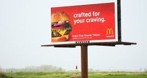 A billboard along a US highway  with advertising for McDonald's, specifically for its Angus Third Pounder Deluxe.
