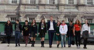 Students Mira Henchi, Theo Cullen-Mouze, Saoi O'Connor, Yasmine Ryan, Emma Kerr, Dan Hatter, Eva Kane, Cian Farrell, Tudor Cucu, Tara O'Neill and Beth Doherty pictured at Leinster House recently after outlining their demands for climate action. Photograph: Alan Betson / The Irish Times