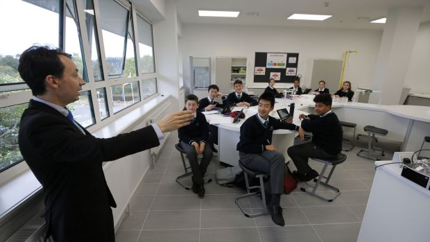 A teacher speaks to his students at the Nord Anglia International School, Leopardstown. The school – which charges fees of up to €24,000 a year – teaches the International Baccalaureate, making it a potential option for wealthy families who might move again before their child's education is finished. Photograph: Nick Bradshaw