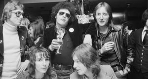 At an after-show party in London, 1974, are (back) Chris Charlesworth of Melody Maker, Charles Shaar Murray and Nick Logan of the NME; and (front) Rob Mackie of Sounds and Chris Briggs of Chrysalis records. Photograph: Erica Echenberg/Redferns