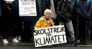 Greta Thunberg, a 16-year-old Swedish environmental activist, attends a protest next to Sweden's parliament in Stockholm on March 8th. The sign reads 'School strike for the climate'. Photograph: Ilze Filks/Reuters