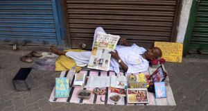 A street astrologer taking rest in hot summer afternoon in Kolkata, India in May, 2013. Photograph: Saikat Paul/Pacific Press/LightRocket/Getty