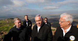Republican US senator Lindsey Graham, Israel prime minister Binyamin Netanyahu    and US ambassador David Friedman at the border line between Israel and Syria at the Israeli-occupied Golan Heights on  March 11th. Photograph: Ronen Zvulun