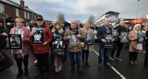 Bloody Sunday family members march ahead of the  announcement of a prosecution over the incident, in Derry, Northern Ireland. Photograph: Charles McQuillan/Getty Images