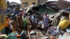 Local people at the scene of the building collapse in Lagos, Nigeria on  Thursday. Photograph: AP/Sunday Alamba