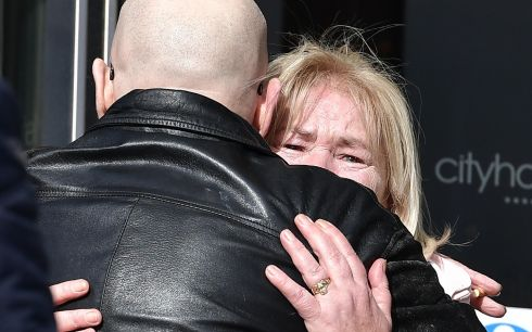 Linda Nash, whose brother William Nash was shot dead on Bloody Sunday, is comforted as she exits the City Hotel after being informed of the prosecution decision in Derry. One out of the 17 soldiers accused of murdering civilians killed on Bloody Sunday will face prosecution. Photograph: Charles McQuillan/Getty Images