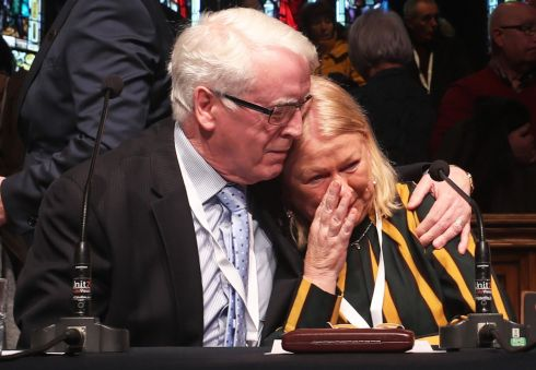 John Kelly comforts Alana Burke at the Guildhall in Derry, after the announcement from the Public Prosecution Service that one former British paratrooper, soldier F is to be charged with two murders and four attempted murders during Bloody Sunday in Derry in 1972. Photograph: Niall Carson/PA Wire